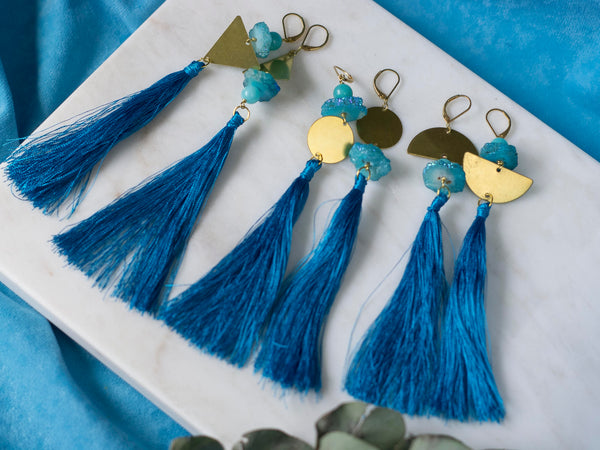 Marici asymmetric blue tassel golden tone brass earrings