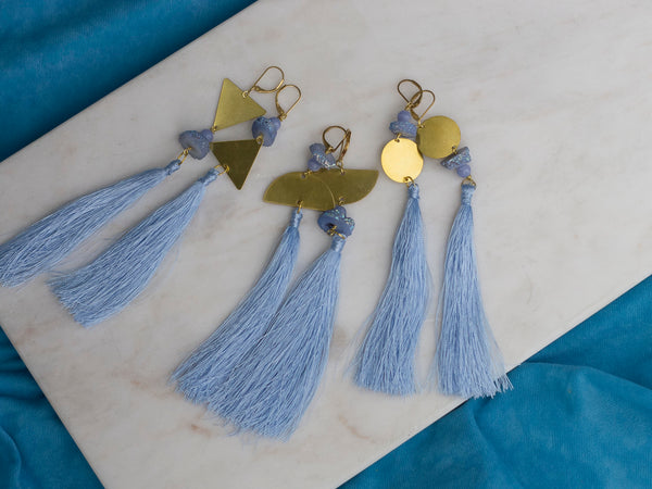 Surya asymmetric blue tassel golden tone brass earrings