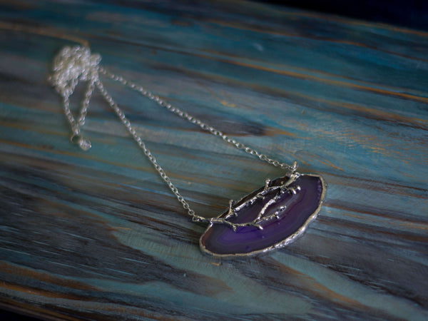 Twilight forest agate slice and twig silver tone pendant
