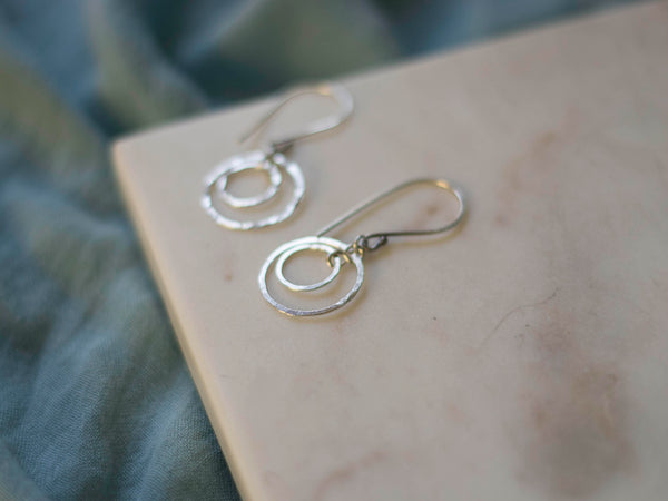 Orbital hoop geometrical silver earrings