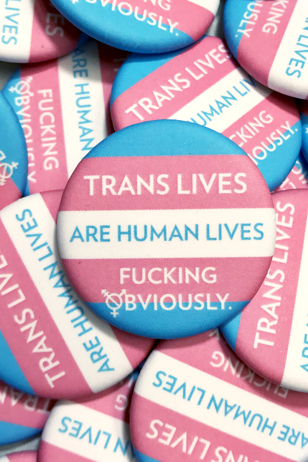 TRANS LIVES ARE HUMAN LIVES BUTTON