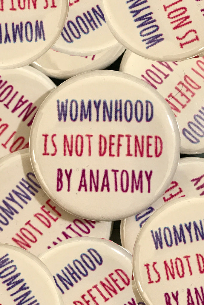WOMYNHOOD BUTTON