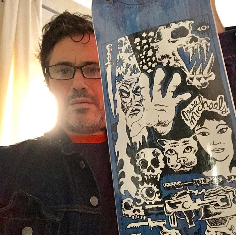 Jesse Michaels with his signature EARTH skateboard
