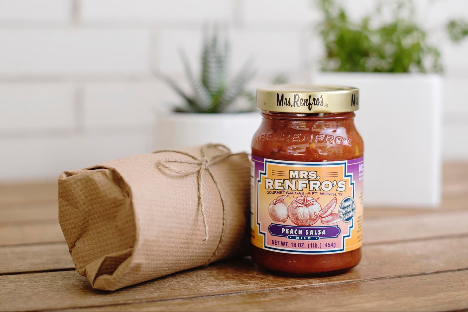 <a href='http://www.renfrofoods.com/' target='_blank'><b>Mrs. Renfro's Peach Salsa</b></a><br>Third Generation family business founded 76 years ago in Fort Worth, TX. Refreshingly smooth, their peach salsa is a real palate pleaser!