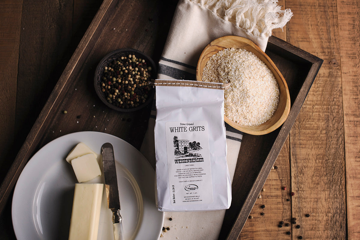<a href='http://www.weisenberger.com/' target='_blank'><b>Stone Ground White Grits by Weisenberger Mill</b></a><br> In operation since the 1800s, Weisenberger Mill of southern Scott County, Kentucky, offers an old-fashioned and hearty Southern grit. Stone-ground from locally grown non-GMO corn, these grits bring forth a nutty, fresh corn taste that will make you a true believer in this regional dish.