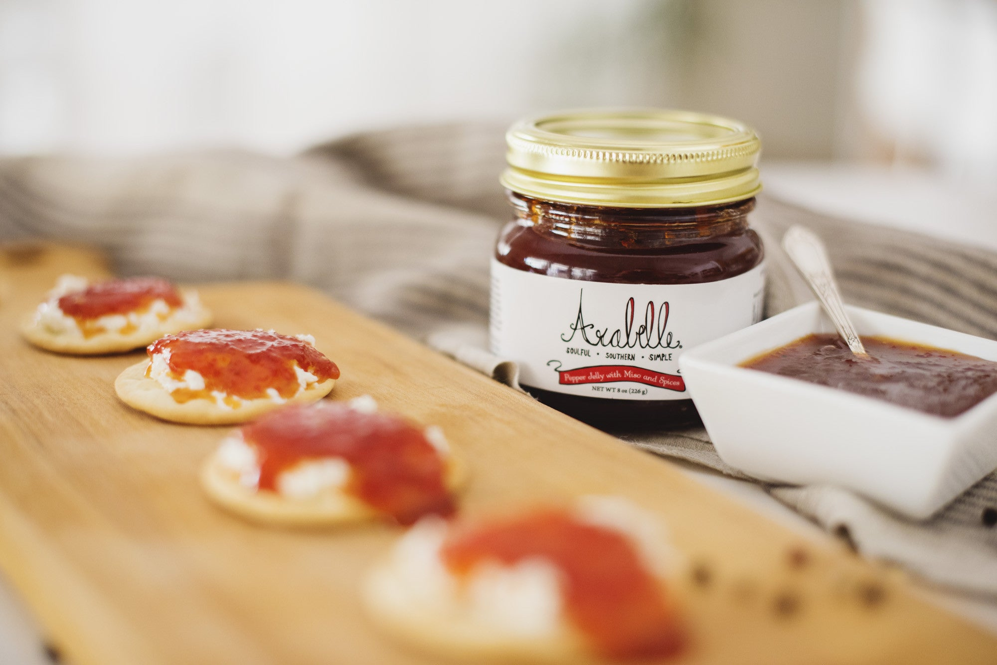 <a href='http://arabellefood.com/product/pepper-jelly-with-miso-spices/' target='_blank'><b>Arabelle Pepper Jelly with Miso and Spices-</b></a><br> This delicious pepper jelly is an Alabama favorite and adds a little kick to every bite. Try it with cream cheese on crackers to start and you'll be adding it to everything soon after.