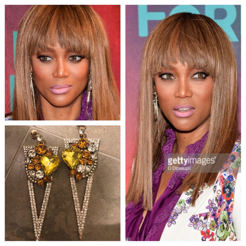 Tyra Banks Wearing Canary Yellow Spike Earrings