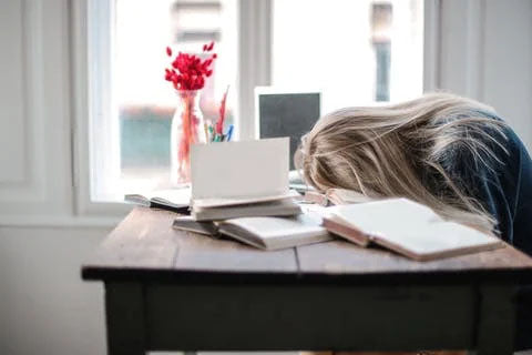 Woman falling asleep on the desk after a stressful evening of w