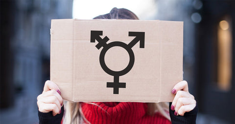 Woman holding up the transgender symbol