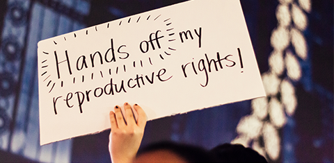 """A sign that says """"hands off my reproductive rights!"""""""
