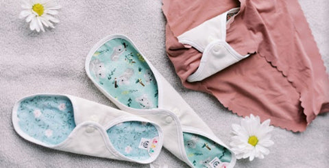 A reusable cloth pads clipped on to underwear
