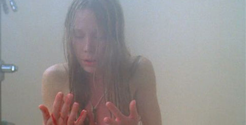Carrie sees her period blood for the first time