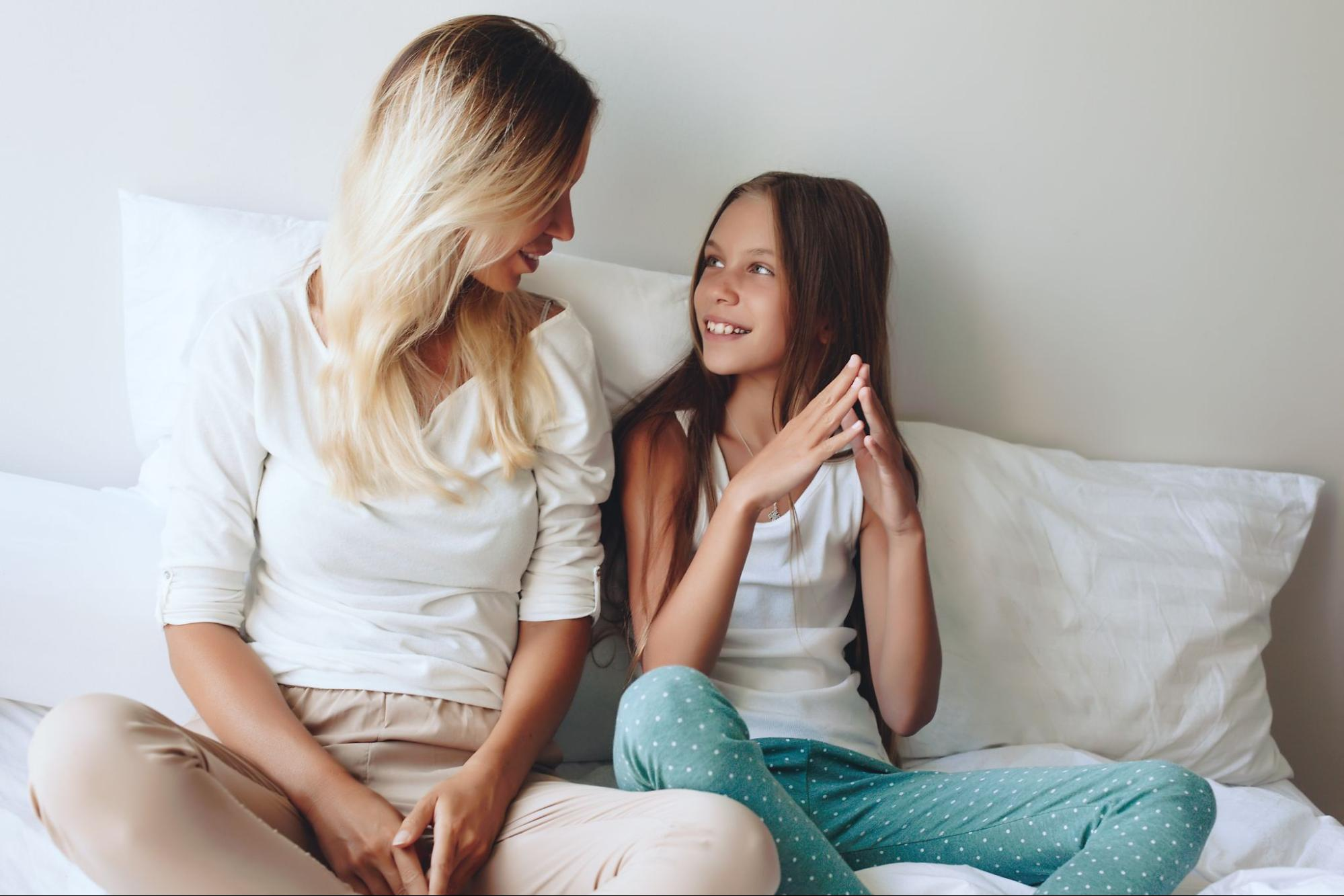 A mom and daughter talking happily