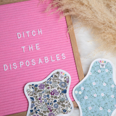 "Close up of some hannahpads and a sign that reads ""ditch the disposables"""