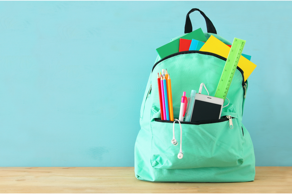 a backpack filled with back to school checklist items
