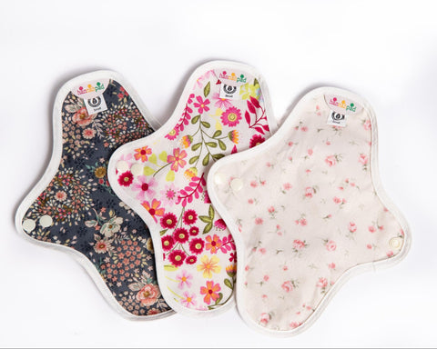 Close up of three hannahpad cloth menstrual pads