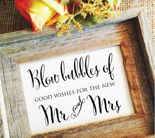 Blow bubbles of good wishes for the new Mr and Mrs Wedding Sign