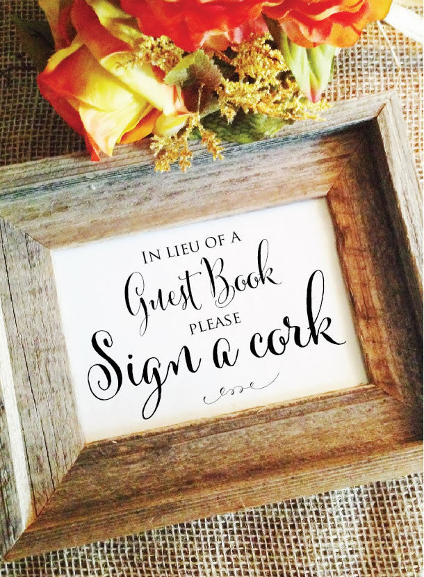 rustic wedding in lieu of guest book please sign a cork