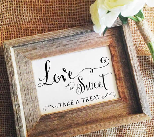Love is sweet sign take a treat wedding sign