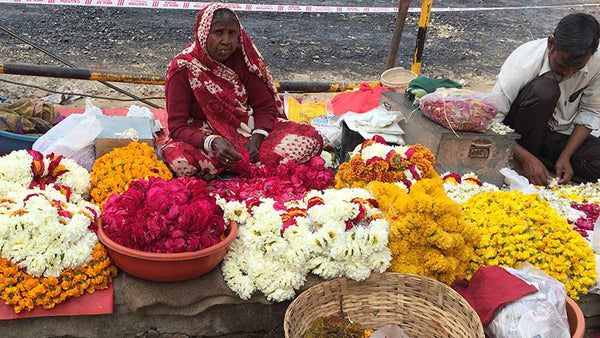 Indian woman selling flowers on the street.