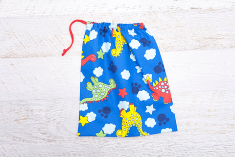 Large drawstring library bag with colourful dinosaurs