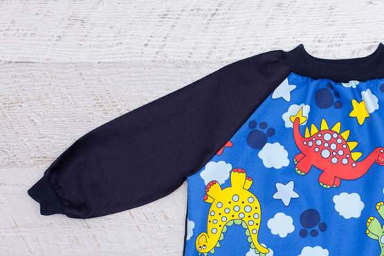 Dinosaur art smock with long navy sleeves