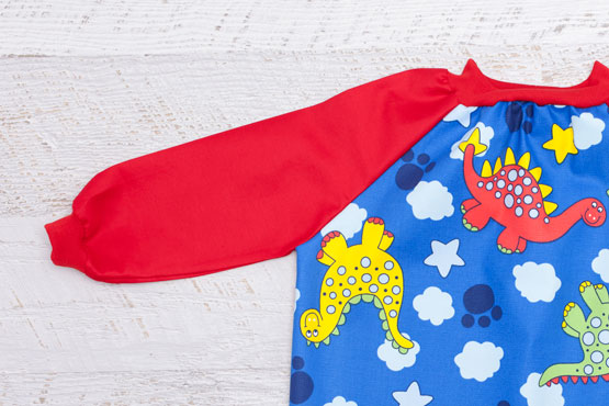 Kids Dinosaur art smock with long red sleeves