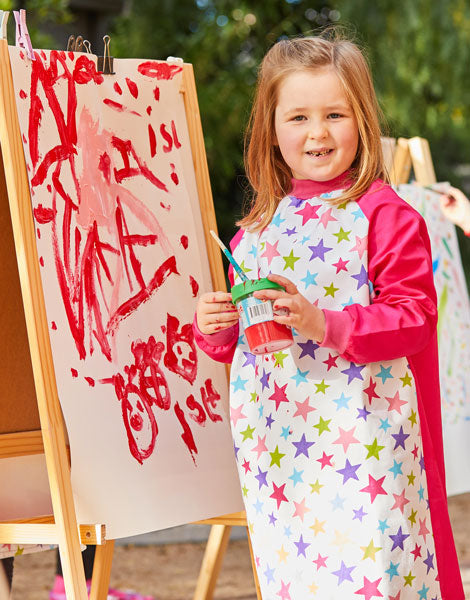 Young girl wearing Pink Stars kids smock for painting
