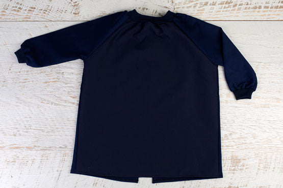 Large art smock in navy blue with long sleeves and open back
