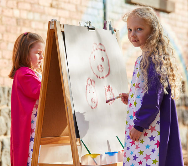 Girl wearing Pink Stars Purple Kids Smock for painting