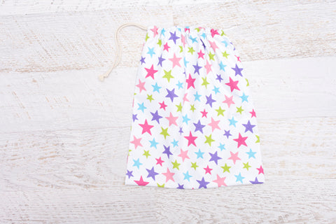 Large drawstring Library Bag which features coloured stars on white background
