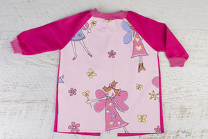 Pale Pink art smock with bright fairies on front and bright pink long sleeves
