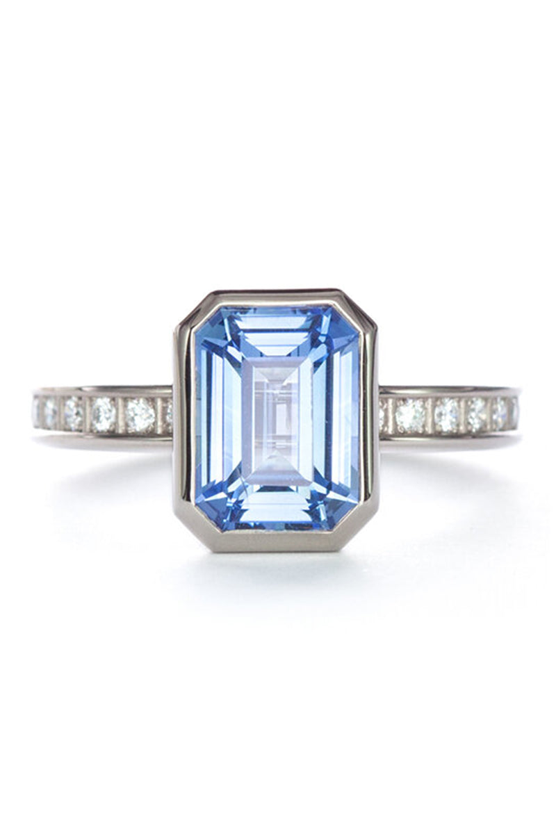 Pixel Dust Solitaire Ring - Emerald Cut Blue Sapphire in Grey Gold