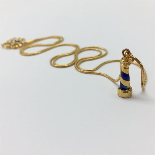 Gold necklace with handcarved blue enamel lighthouse charm