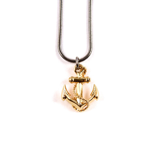 Gold anchor boyfriend pendant on a ruthenium snake chain.