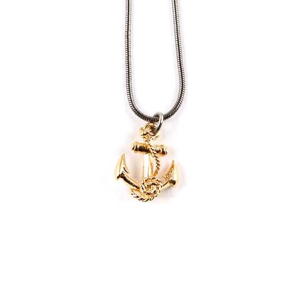 Gold anchor pendant on a ruthenium snake chain.