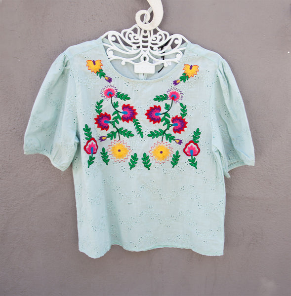 Pastel embroidered tops.