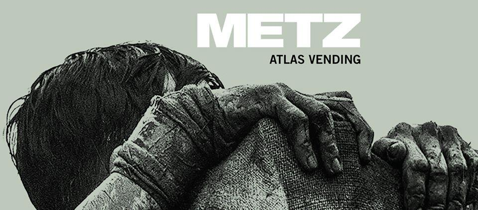 METZ Atlas Vending banner with man grasping onto ledge in grey