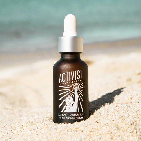 Brightening hydrating serum with vitamin C and hyaluronic acid for dull, dehydrated skin with sun spots and hyperpigmentation in sustainable, low waste / zero waste refillable bottles from Activist Skincare