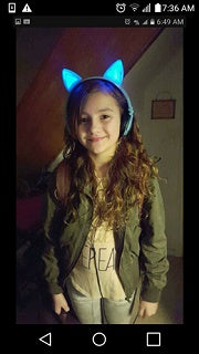 Isabella Polanco in the Cat LED Headphones from Exclusive Offers and she love it a lot