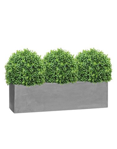 Grey window box planters with artificial buxus balls