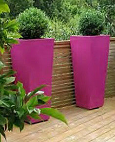 Bright Coloured Planters. Tall colourful outdoor planters.