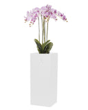 Large artificial orchid arrangement in floor standing white planter