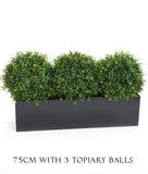Artificial topiary balls, window boxes, trough planters.