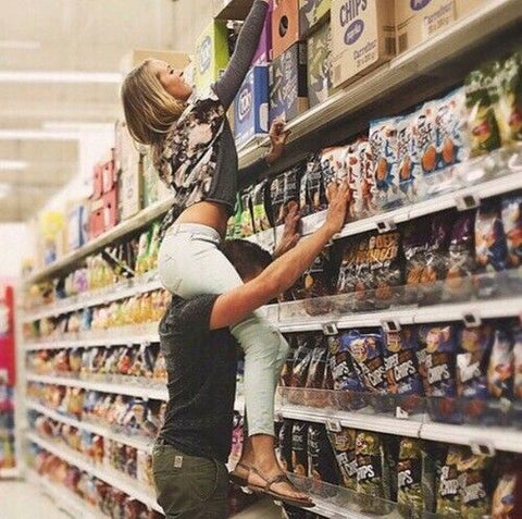 Tall boyfriend and short girlfriend in grocery store