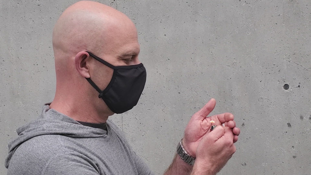 The Navas Lab Apparel reusable face mask in black.