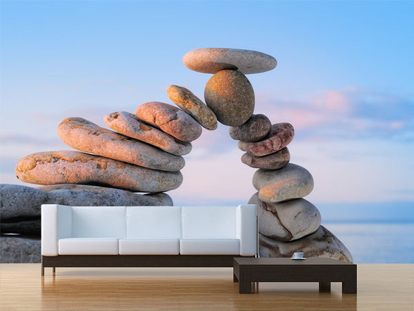 White Pebbles on the Shore at Sunrise Wall Mural