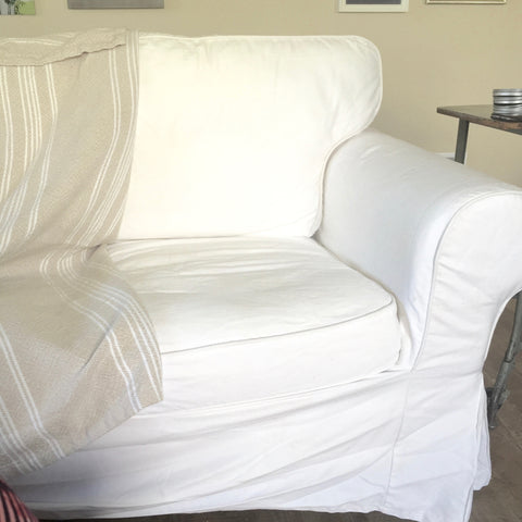 white couch, wrinkles,