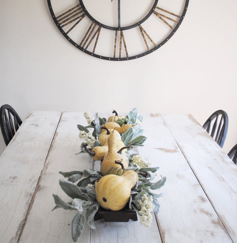 The dining space has been decorated with a simple chicken feeder centerpiece. I have these available in the shop and I just love their rusted finish: it adds a great texture