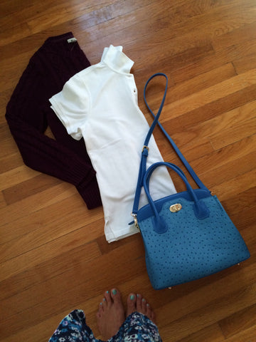 burgundy sweater, white polo, blue bag